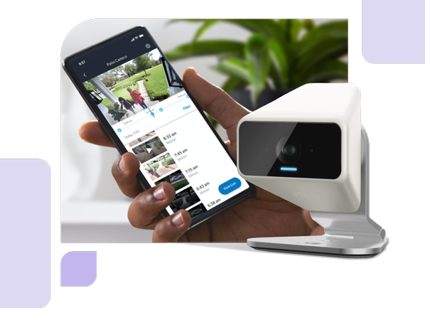 Xfinity Camera device on front of a image of a hand holding  a cellphone. devices shows a video recording